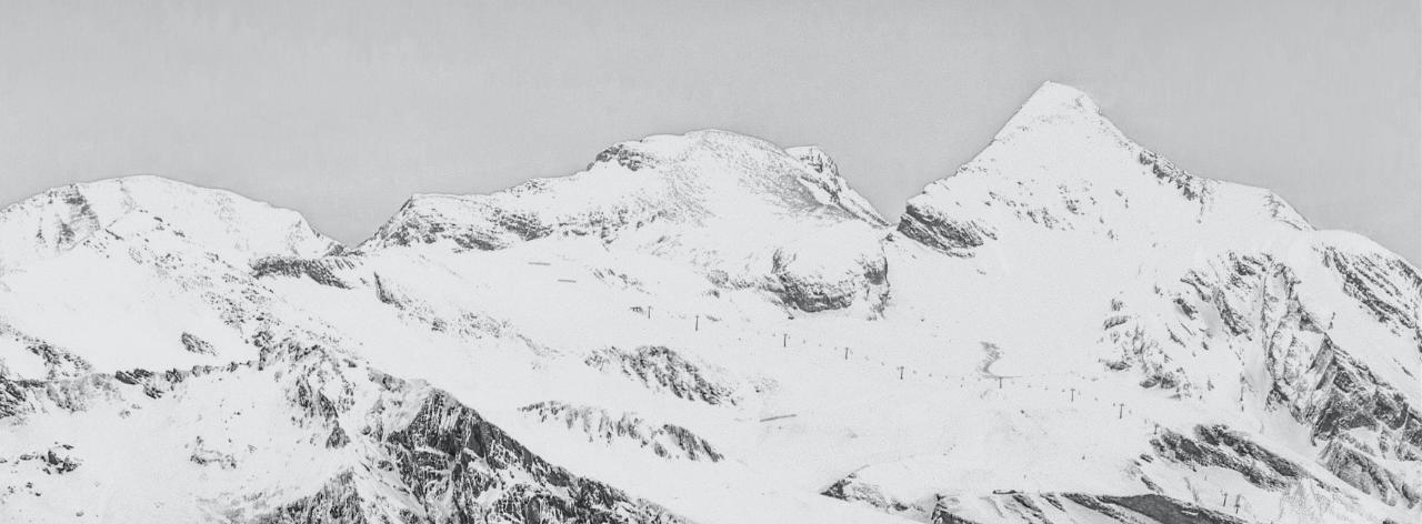 Greyscale snowy mountain peaks