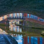 View of Birmingham canal from under a bridge